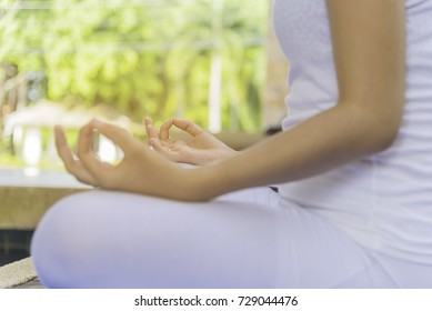Asian woman wear sport wear,sitting on blue yoga map,meditation pose,elective focus.