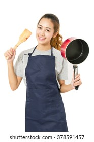 Asian Woman Wearing Apron And Showing Pan With Utensil