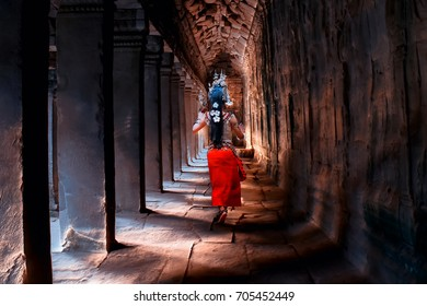Asian woman wearing cambodia traditional dress in stone castle