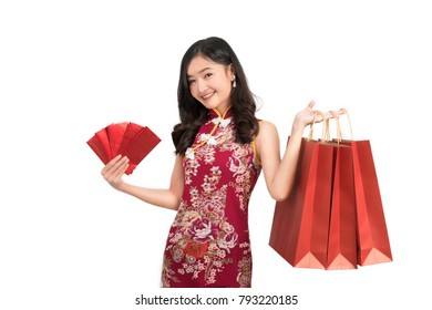 Asian woman wearing chinese dress hold Red envelopes and shopping bag cheongsam,qipao smile in chinese new year on white isolated background