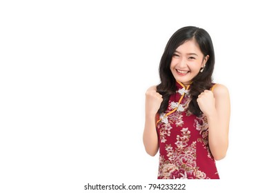 Asian woman wearing chinese dress feel excited or cheongsam,qipao smile in chinese new year on white isolated background