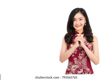 Asian woman wearing chinese dress congratulation or cheongsam,qipao smile in chinese new year on white isolated background