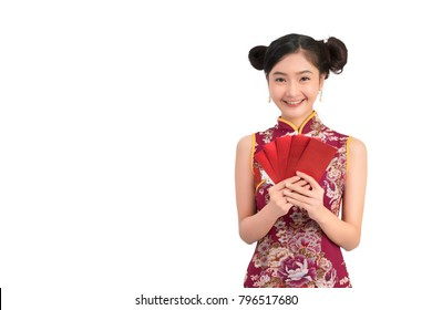 Asian woman wearing chinese dress hold red envelopes or cheongsam,qipao smile in chinese new year on white isolated background
