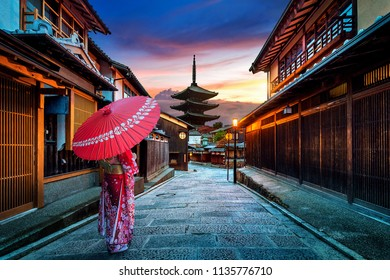 Asian woman wearing japanese traditional kimono at Yasaka Pagoda and Sannen Zaka Street in Kyoto, Japan.