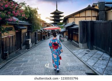 Asian woman wearing japanese traditional kimono at Yasaka Pagoda and Sannen Zaka Street in Kyoto, Japan.