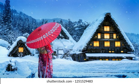 Asian woman wearing japanese traditional kimono at Shirakawa-go village in winter, UNESCO world heritage sites, Japan.