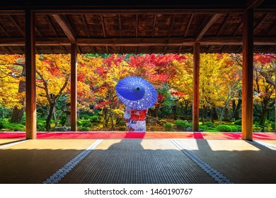 Asian woman wearing japanese traditional kimono in autumn at Enkoji temple, Kyoto, Japan.