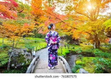 Asian woman wearing japanese traditional kimono in autumn park. Japan