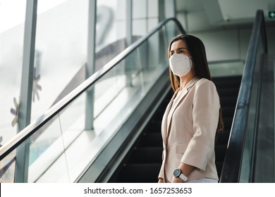 Asian woman wearing N95 mask to protect pollution PM2.5 and virus. COVID-19 Coronavirus and Air pollution pm2.5 concept. - Shutterstock ID 1657253653
