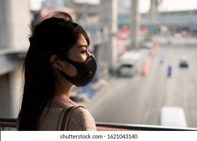 Asian woman wearing protection mask for prevent air pollution, Dust PM 2.5. Problems found in major cities around the world. air pollution, Environmental pollution concept