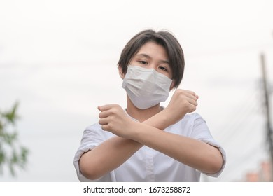 Asian woman wearing a protective face mask for plague corona virus.