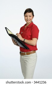 Asian woman wearing red shirt writing in black folio