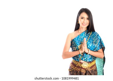 Asian woman wearing typical,traditional Thai dress with identity Thai culture Sawasdee,Welcome expression Sawasdee, isolated on white background