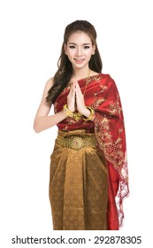 Asian woman wearing typical,traditional Thai dress with identity Thai culture Sawasdee,Welcome expression Sawasdee,vintage Thai girl,Happy asian woman with blank copyspace,isolated on white background