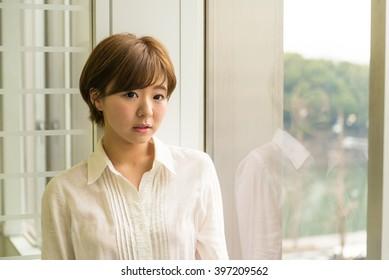 asian woman wearing white shirts