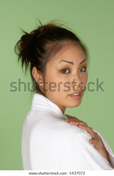 Asian Woman in White Bath Robe