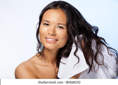 Asian woman wiping wet hairs after bathroom with blanket with happy smile on her face