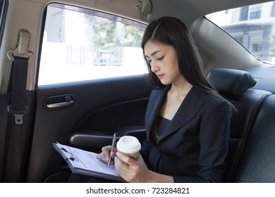 Asian Woman working in Car, Woman working concept.