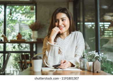 Asian woman working in coffee shop
