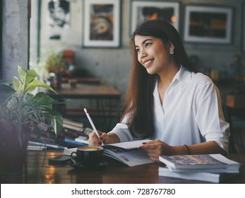 Asian woman working in coffee shop cafe concept