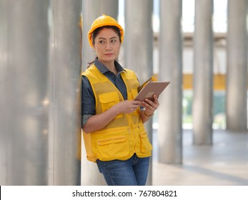 Asian woman working engineering in site building