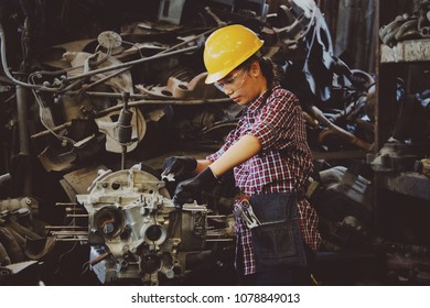 Asian woman working in factory with machine engineering concept
