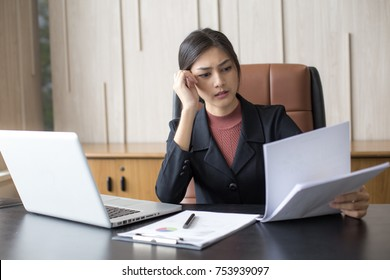 Asian woman working  hard with serious emotion at office, woman working hard concept.