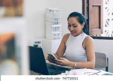 asian woman working at home office