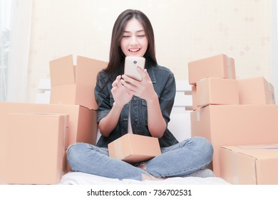 Asian Woman Working at home with Online Business or SME Concept. Young owner happy woman Start up for Business Online happy with orders, SME, Delivery Project,  SME Concept.