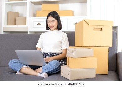 Asian woman working at home. People with SME, Delivery, Online Business success concept.