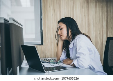 Asian woman working in office,young business woman stressed from work overload with a lot file on the desk,Thailand people