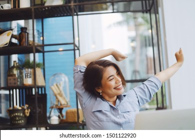 Asian woman working in office,she's painful around neck and shoulder during working with laptop.
