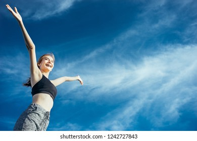 Asian woman is workout and running at the morning, she is warm up her body and drinking water. Healty and sport lifestyle concept.