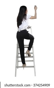 Asian woman write something with pen on the ladder isolated over white background