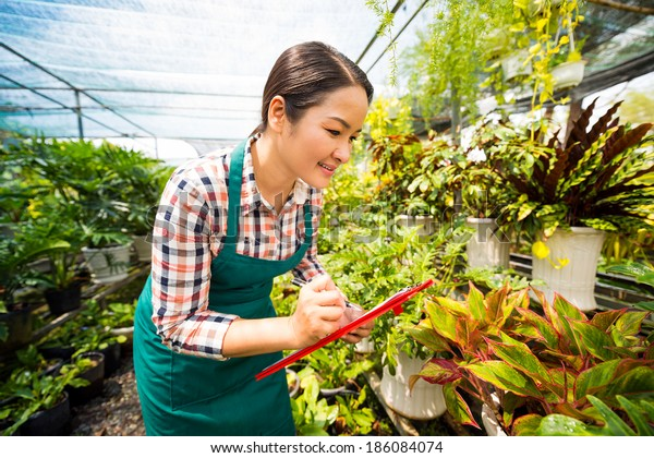 Asian Woman Writing Down Names Plants Stock Photo (Edit Now) 186084074