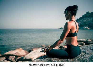 Asian woman yoga on the beach vintage color