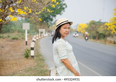 asian woman.thai woman with blooming flowers.
