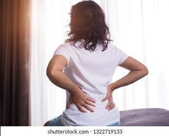 Asian women, back pain and lumbar muscle pain. Musculoskeletal problems Or office syndrome.