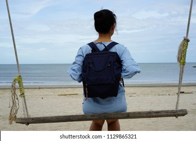 Asian women backpack View of the sea