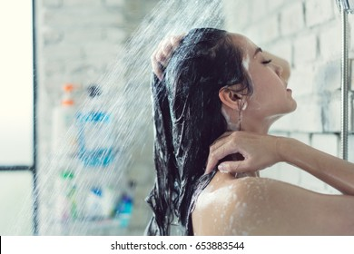 Asian women bathing and she was bathing and washing hair.she is happy