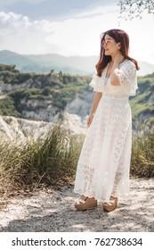 Asian women (Bride) wear white dress at forest.