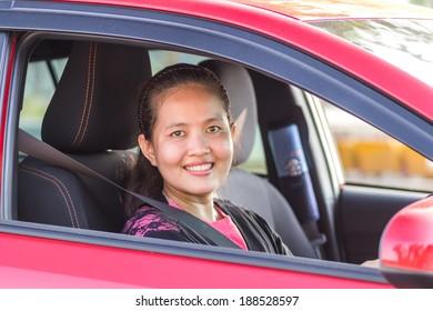 Asian women in a car.