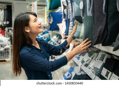 Asian women are choosing to buy new pillows in the mall. Shopping for groceries and housewares are needed in markets, supermarkets or big shopping centres.