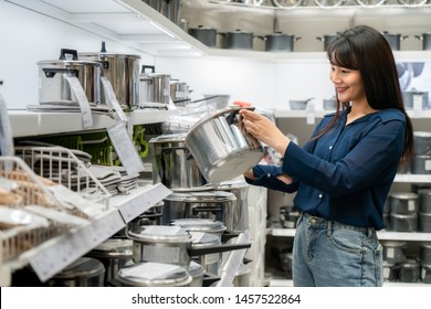 Asian women are choosing to buy new kitchenware in the mall. Shopping for groceries and housewares are needed in markets, supermarkets or big shopping centres.