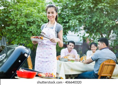 Asian women are cooking a barbecue to eat a friend