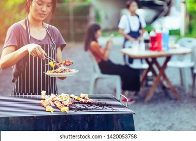Asian women are cooking for a group of friends to eat barbecue at home.