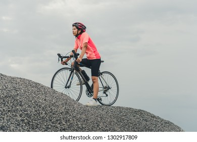 Asian women are cycling road bike in the morning