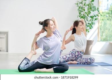 Asian women doing yoga indoor