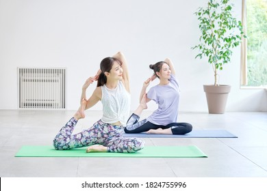 Asian women doing yoga in the room