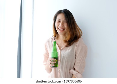 Asian women drinking beer at party, celebration, lifestyle